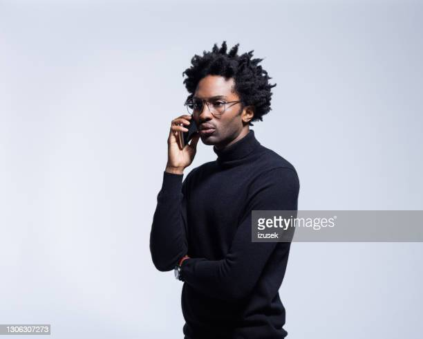 portrait of serious man in black turtleneck - polo neck stock pictures, royalty-free photos & images