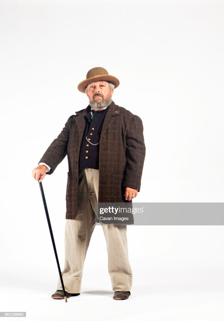 Portrait of serious man in retro styled costume against white background : Stock Photo
