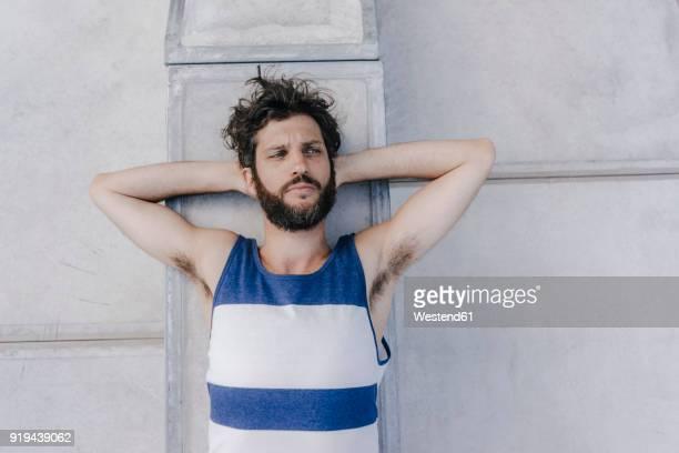 portrait of serious man lying in skatepark - homens de idade mediana - fotografias e filmes do acervo