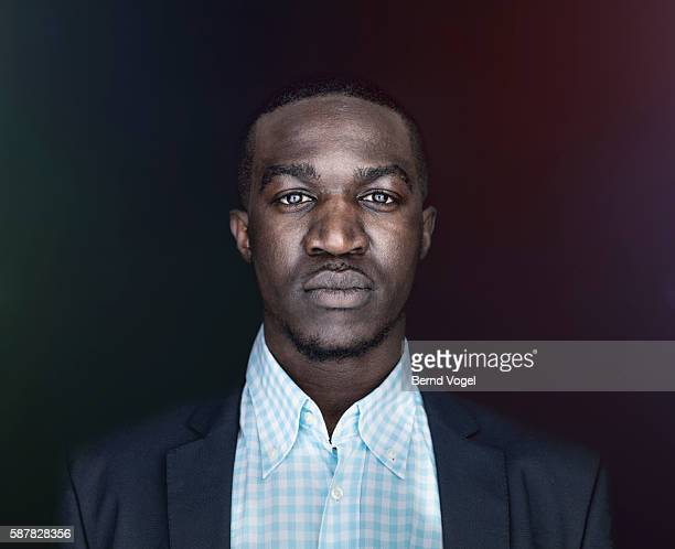 portrait of serious man - menswear stock pictures, royalty-free photos & images