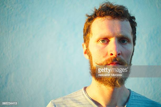 portrait of serious man with beard - saturated colour stock pictures, royalty-free photos & images