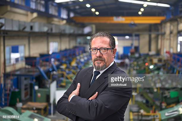 Portrait of serious manager in factory