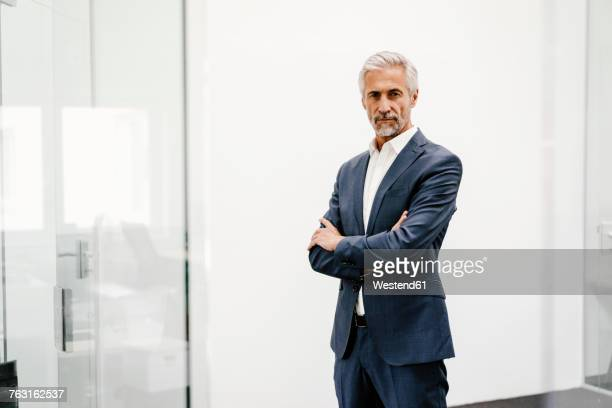 portrait of serious mature businessman in office - three quarter front view stock pictures, royalty-free photos & images
