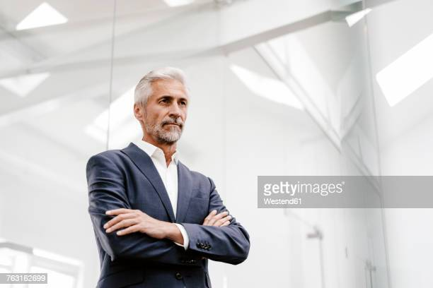 portrait of serious mature businessman in office - looking away stock pictures, royalty-free photos & images