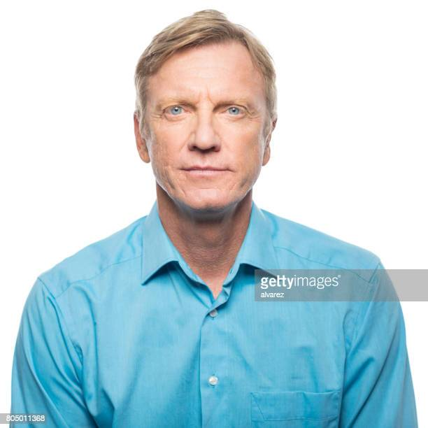 portrait of serious mid adult man - waist up stock pictures, royalty-free photos & images