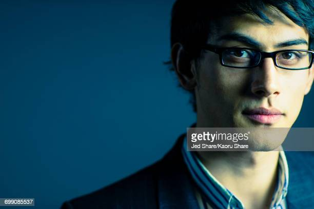 portrait of serious mixed race businessman - ハンサム ストックフォトと画像