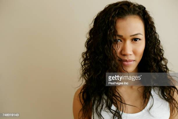 portrait of serious mixed race woman - pacific islanders stock pictures, royalty-free photos & images