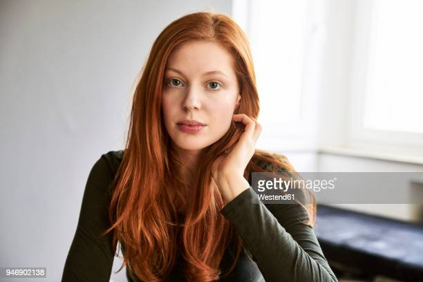 portrait of serious redheaded woman - redhead stock pictures, royalty-free photos & images