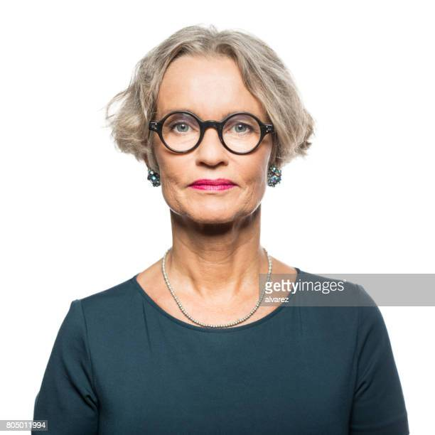 portrait of serious senior woman - blank expression stock pictures, royalty-free photos & images