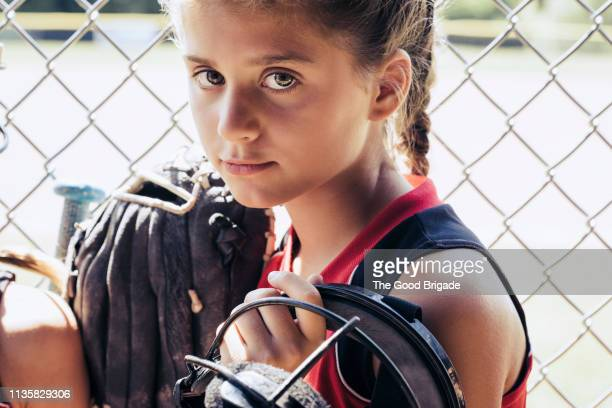 portrait of serious softball player in dugout - face guard sport stock pictures, royalty-free photos & images