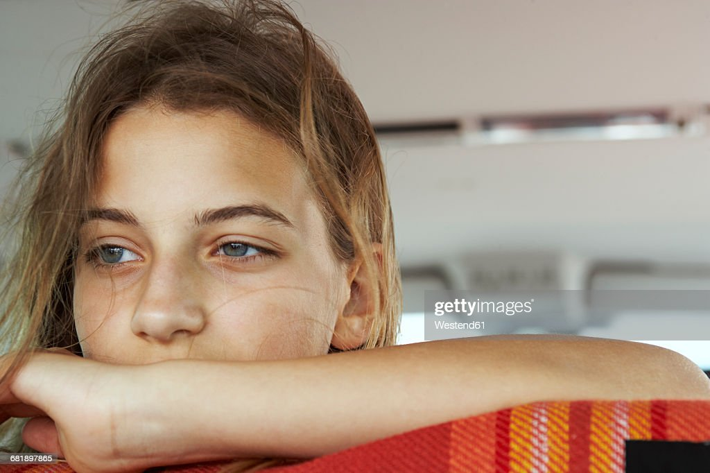 Portrait of serious teenage girl inside car : Stock Photo