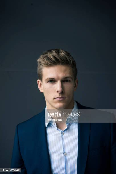 portrait of serious young businessman - white blazer stock pictures, royalty-free photos & images