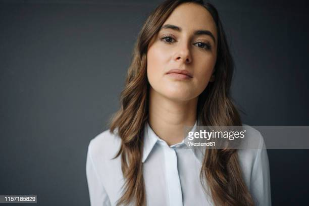 portrait of serious young businesswoman - one young woman only stock pictures, royalty-free photos & images