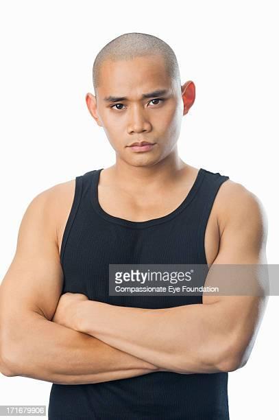 portrait of serious young man - ärmellos stock-fotos und bilder