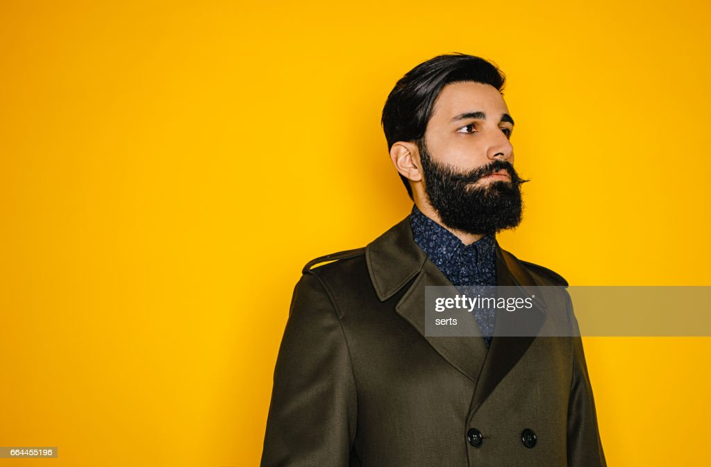 Portrait of serious young man with beard : Stock Photo