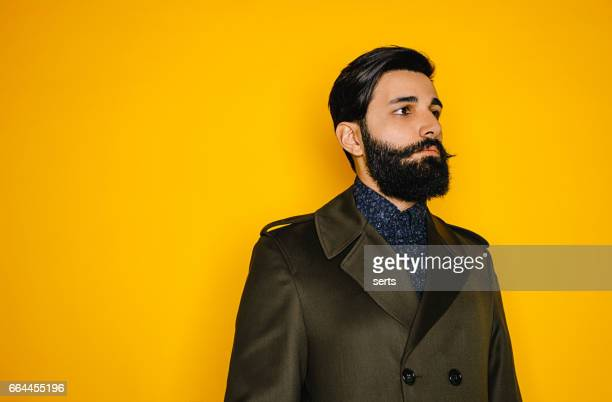 portrait of serious young man with beard - beard stock pictures, royalty-free photos & images
