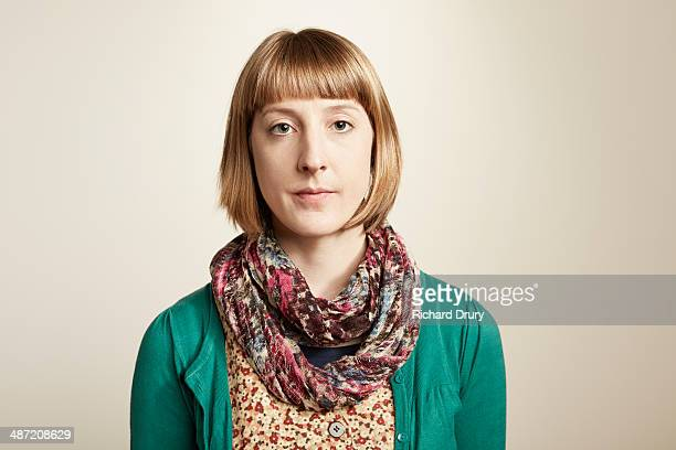 portrait of serious young woman looking to camera - blank expression stock pictures, royalty-free photos & images