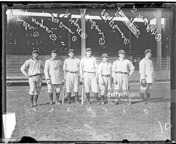 Portrait of several members of the Pittsburgh Pirates baseball team as they pose on the field at West Side Grounds Chicago Illinois 1909 They are...