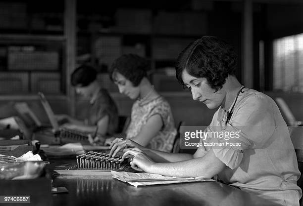 Portrait of several women at work in an office early twentieth century Though the image is originally titled 'Typists' the women actually use adding...