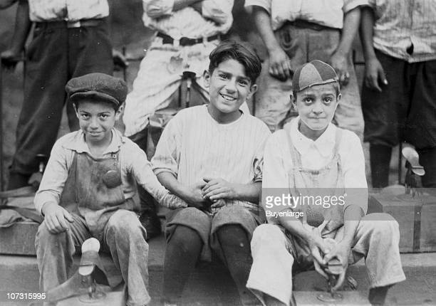 Portrait of several young shoe shiners as they pose together Hartford Connecticut August 25 1924