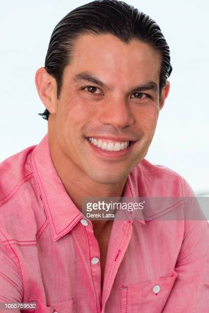 Portrait of sexy and attractive Asian American male in casual shirt smiling'n