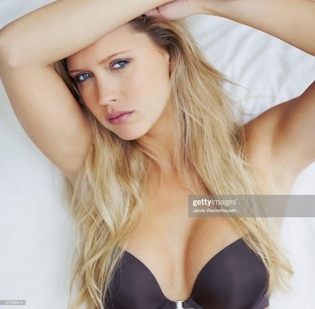Portrait of sexy female wearing a black bra : Stock Photo