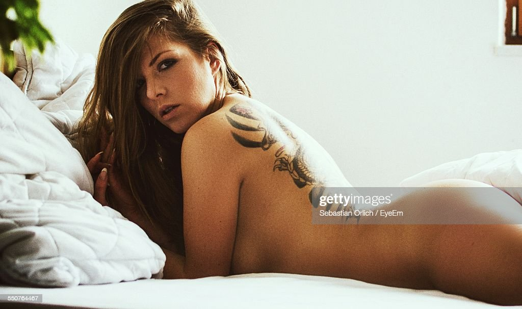 Portrait Of Sexy Naked Beautiful Woman On Bed At Home High Res