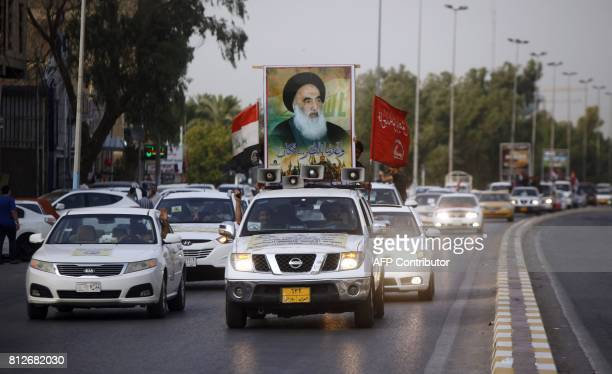 Portrait of Shiite cleric Grand Ayatollah Ali al-Sistani is seen in the city of Najaf on July 11, 2017 as Iraqis take to the streets to celebrate a...