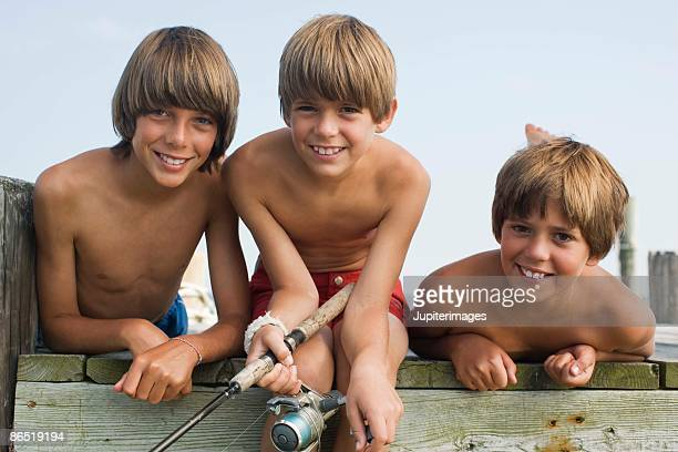 Portrait of shirtless boys outdoors
