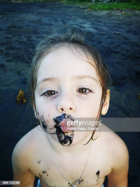 Portrait Of Shirtless Girl With Messy Face Puckering Lips