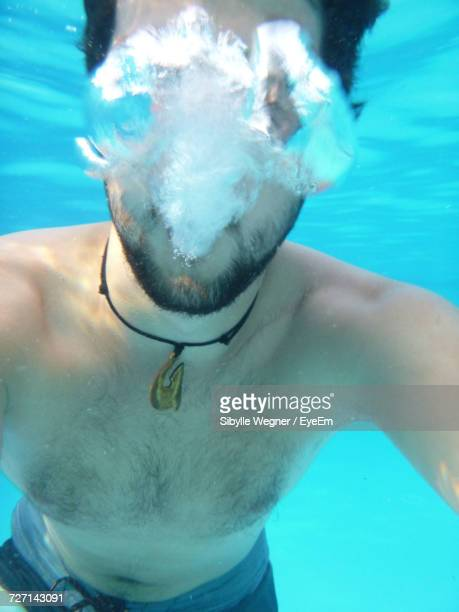 Portrait Of Shirtless Man In Swimming Pool