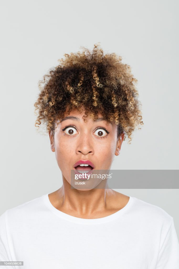 deace0a0be3 Portrait Of Shocked Afro American Woman Stock Photo - Getty Images