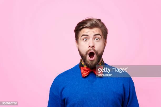 portrait of shocked man at studio shot. debica, poland - encuadre cintura para arriba fotografías e imágenes de stock