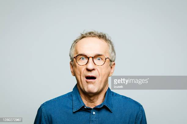 portrait of shocked senior man - human face stock pictures, royalty-free photos & images