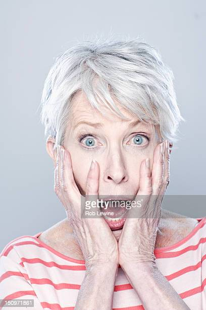 Portrait of shocked senior woman, studio shot