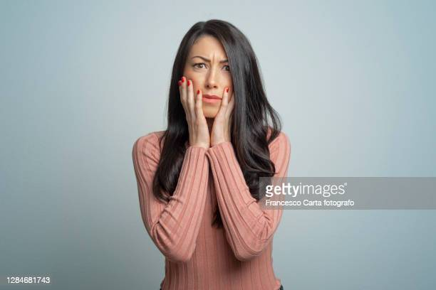 portrait of shocked woman - anxiety stock pictures, royalty-free photos & images