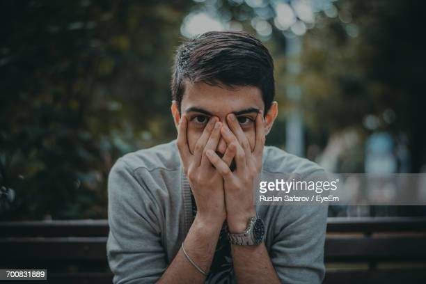 portrait of shocked young man - hands covering mouth stock pictures, royalty-free photos & images