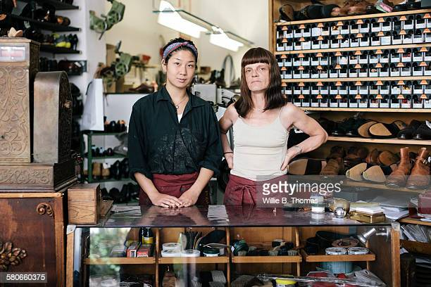 portrait of shoemaker and apprentice - shoemaker stock photos and pictures