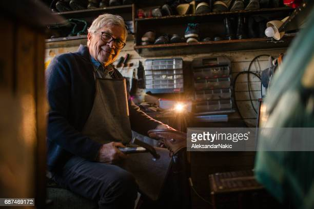 portrait of shoemaker - shoemaker stock photos and pictures