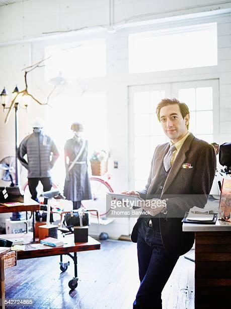 Portrait of shop owner holding digital tablet