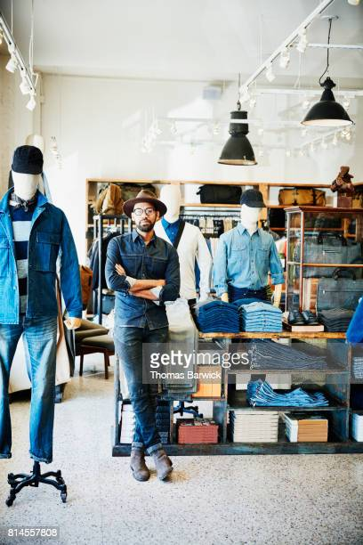 Portrait of shop owner in mens clothing boutique