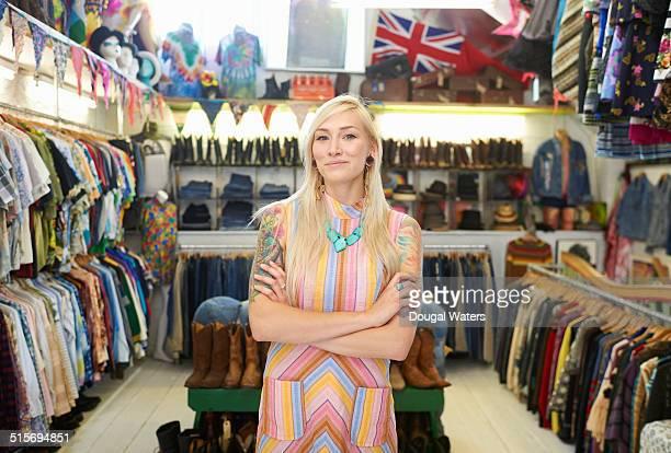 Portrait of shop owner in vintage clothes shop.
