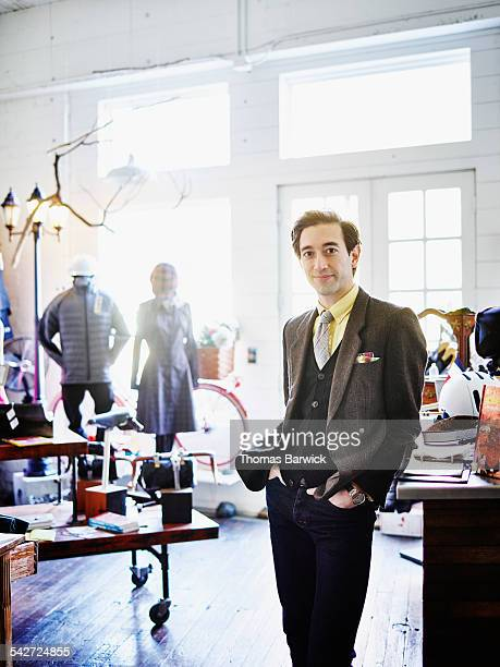 Portrait of shop owner standing in boutique