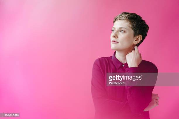 portrait of short-haired woman - one mid adult woman only stock pictures, royalty-free photos & images