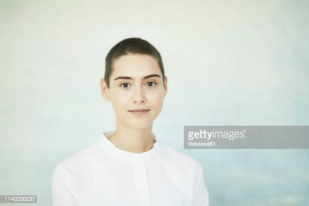 portrait of short-haired young woman - 優美 ストックフォトと画像
