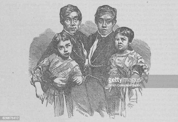 Portrait of Siamese twins Chang and Eng Bunker posing with their children 1865