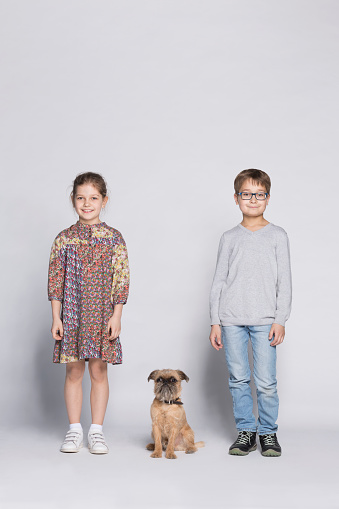 Portrait of siblings with dog against white background - gettyimageskorea