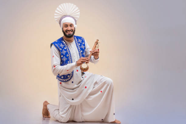 Portrait Of Sikh Man Doing Bhangra Dance