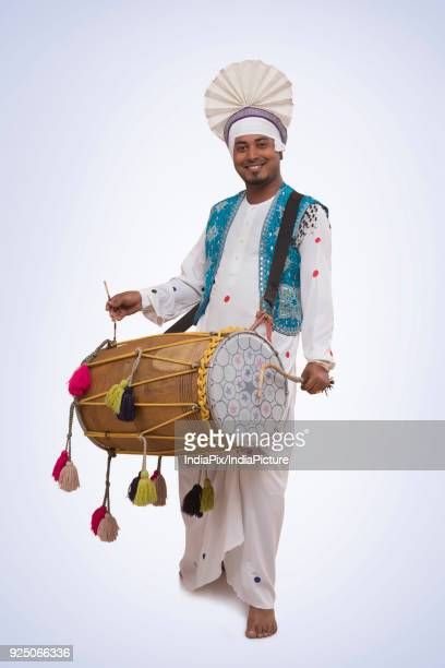 portrait of sikh man playing on drums - lohri festival stock pictures, royalty-free photos & images