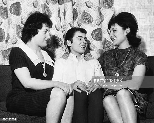 Portrait of singer actor and jockey Davy Jones pictured with his sisters Beryl and Linda after being cast in musical 'Oliver' as the Artful Dodger at...